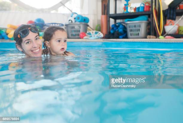 Baby swimming lessons for an infant with a qualified coach.
