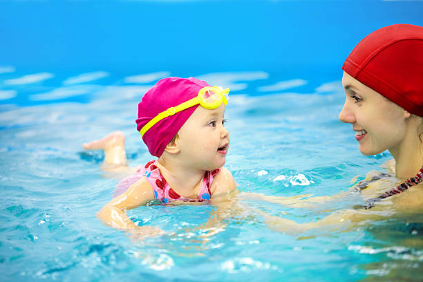 parents children relationship in swimming lesson and