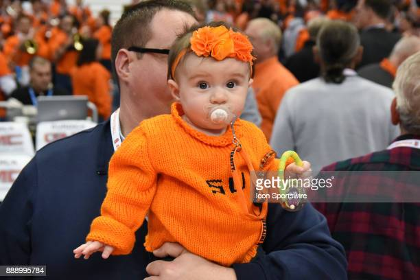 Baby Syracuse Orange fan cheers on her favorite team during the second half of play between the Syracuse Orange and the Colgate Raiders on December...