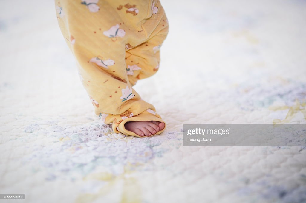 Baby taking first steps : Stock Photo