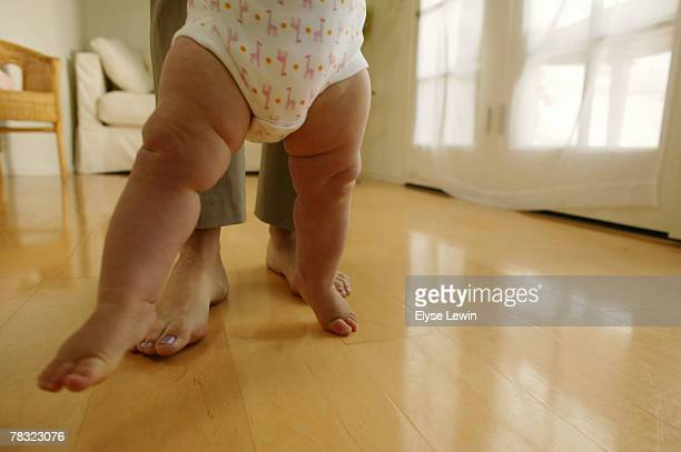 Baby taking first steps