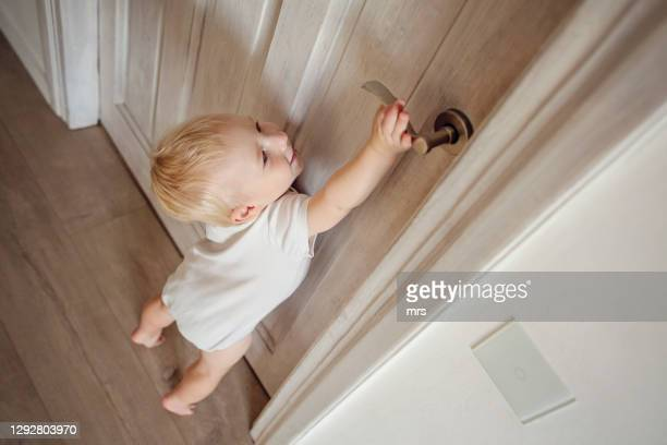 baby trying to reach door handle - one baby boy only stock pictures, royalty-free photos & images