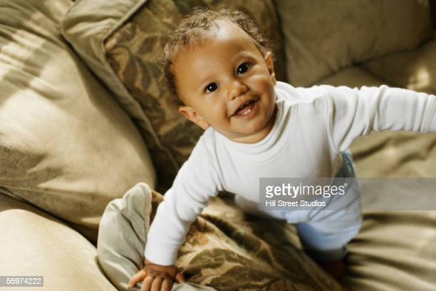 baby trying to stand - north african ethnicity stock pictures, royalty-free photos & images