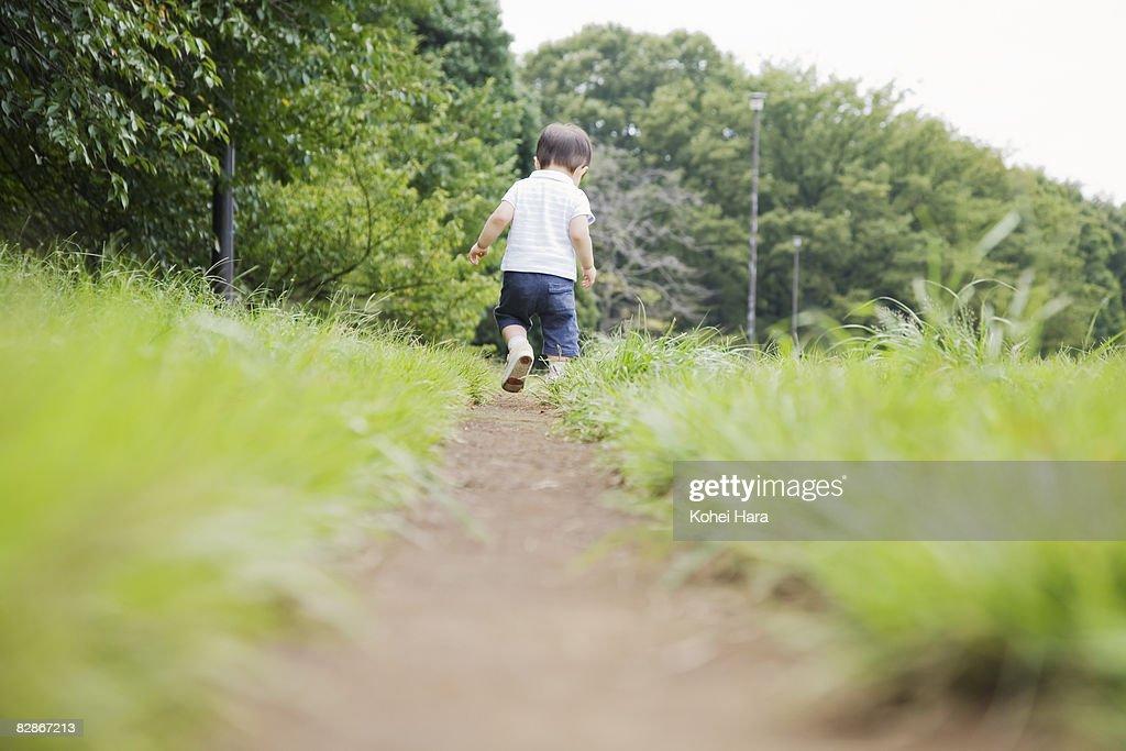 baby walking on path : Stock Photo