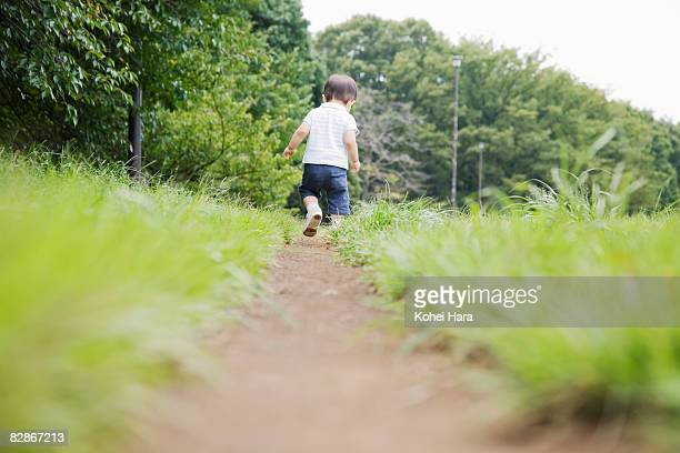 baby walking on path