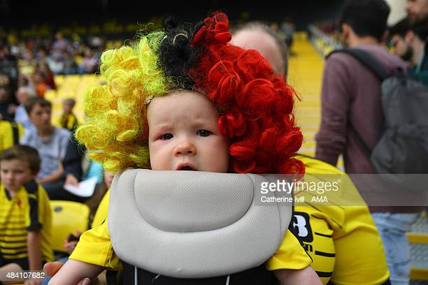 A baby wearing a Watford wig during the Barclays premier League match between Watford and West Bromwich Albion at Vicarage Road on August 15 2015 in...