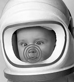 baby cross eyed wearing toy astronaut