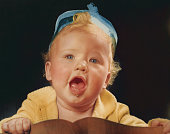 baby girl with mouth open