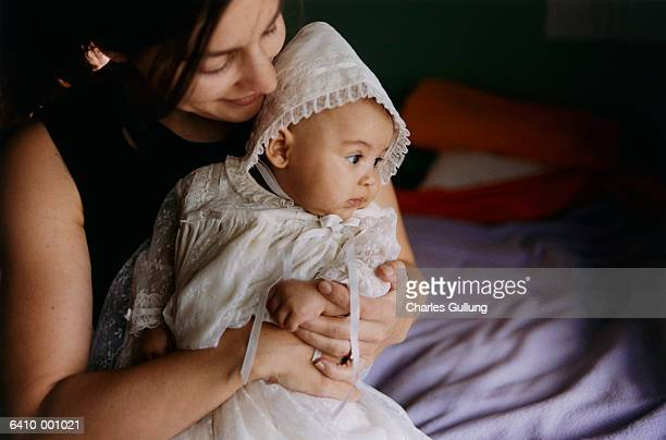 baby wearing christening gown - christening gown stock pictures, royalty-free photos & images