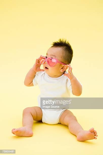 Baby wearing heart shape sunglasses