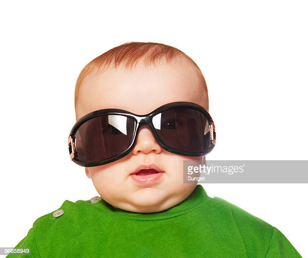 Baby wearing large sunglasses