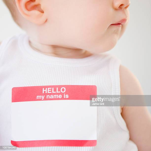 baby wearing name tag - identity stock photos and pictures
