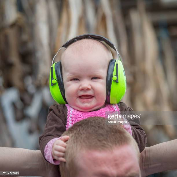 Baby wearing noise reduction ear muffs