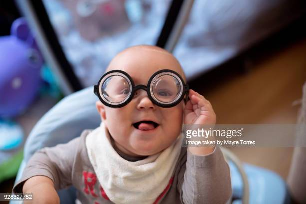 baby wearing short sighted glasses - small faces stock pictures, royalty-free photos & images