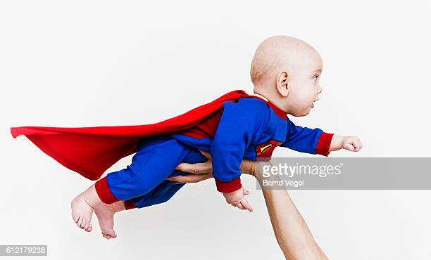 Baby wearing super hero outfit