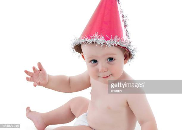baby with a party hat