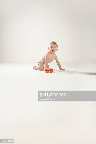 Baby with a toy train