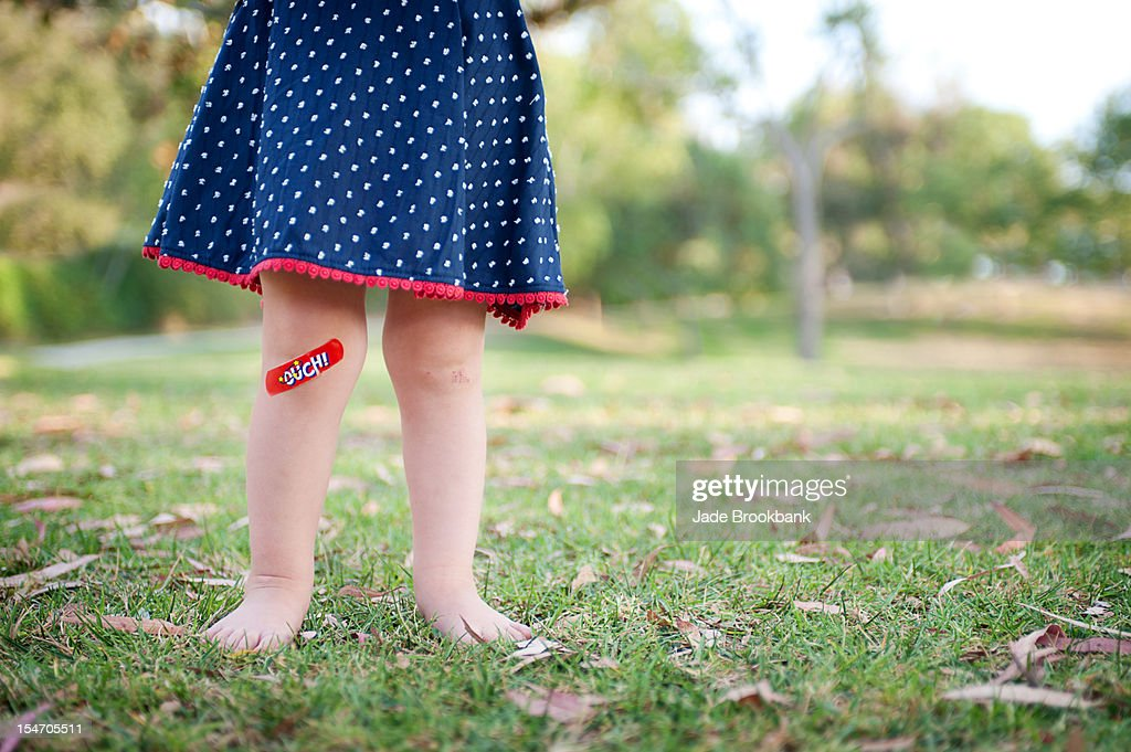Baby with bandaid : Stock Photo