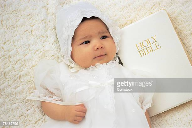 baby with bible - baptism stock pictures, royalty-free photos & images
