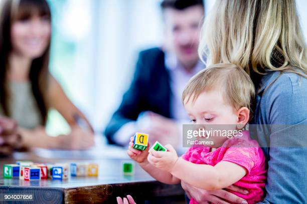 baby with blocks - nanny stock photos and pictures