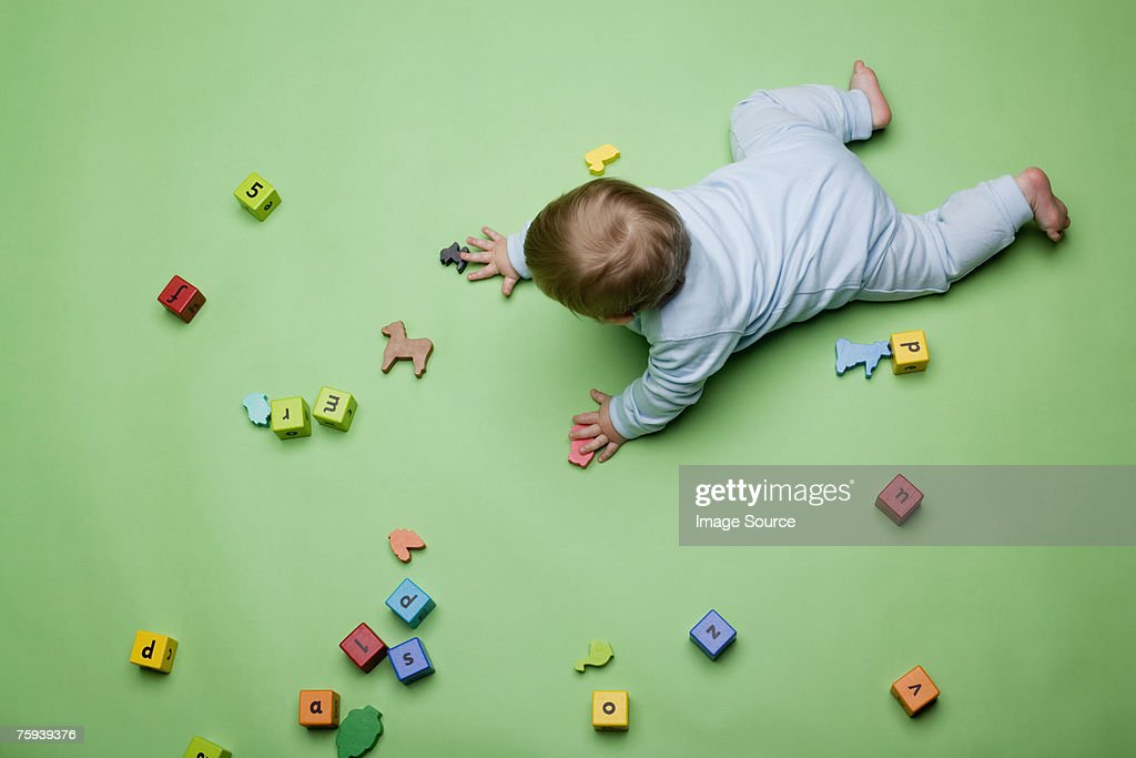 Baby with building blocks : Stock Photo