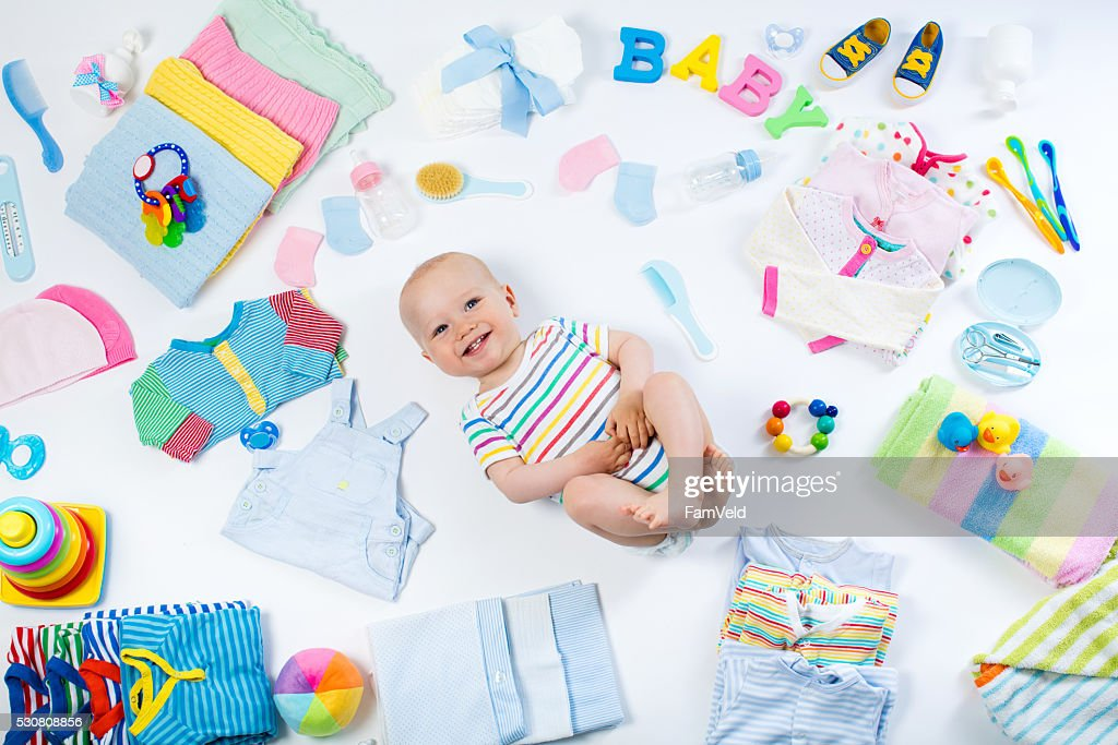 Baby with clothing and infant care items : Stock Photo