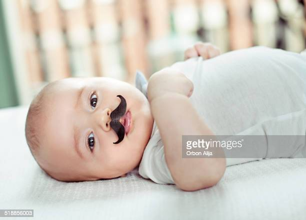 Baby with fake mustache