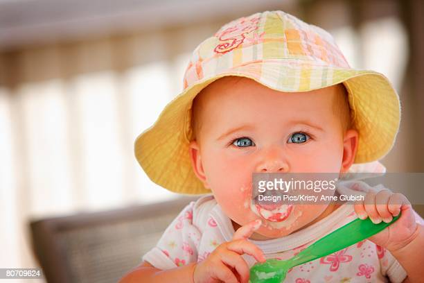 A baby with food on her face