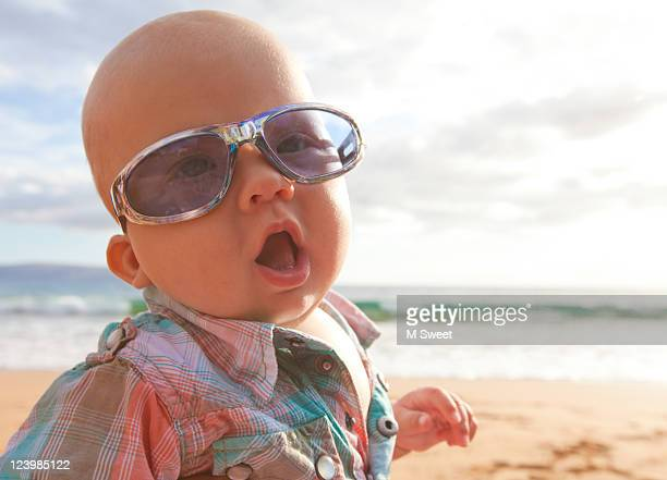 Baby with funny faces at beach