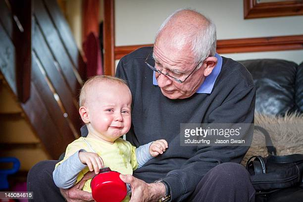 baby with grandfather - s0ulsurfing stock pictures, royalty-free photos & images