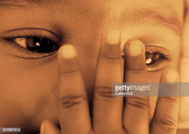Baby with Hand Covering Nose