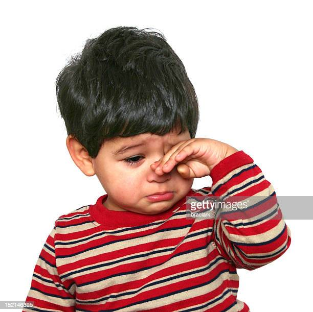 Baby with hand on face feeling sad