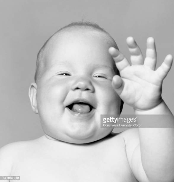 baby with hand up and mouth open - {{relatedsearchurl(carousel.phrase)}} imagens e fotografias de stock