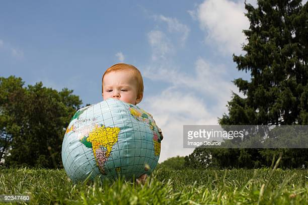 Baby with inflatable globe