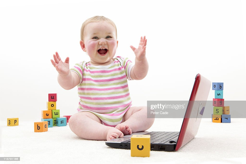baby with learning bricks and laptop : Stock Photo