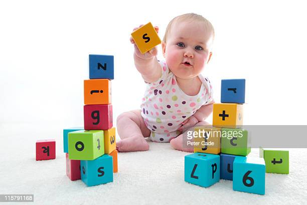 baby with learning bricks
