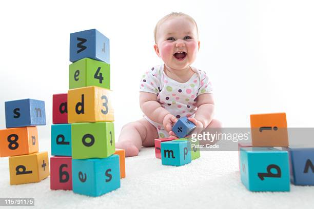 baby with learning bricks - babies only stock pictures, royalty-free photos & images