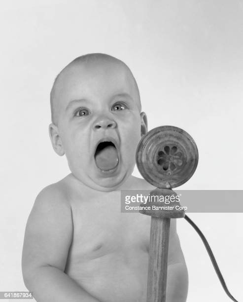 baby with microphone and mouth open - {{relatedsearchurl(carousel.phrase)}} imagens e fotografias de stock