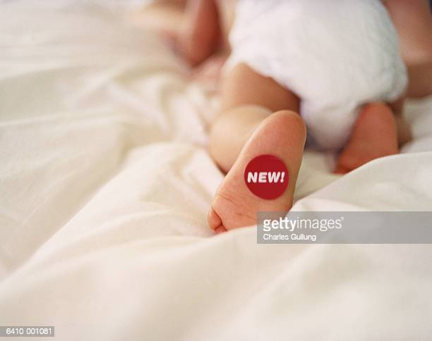 Baby with 'New' Label on Foot