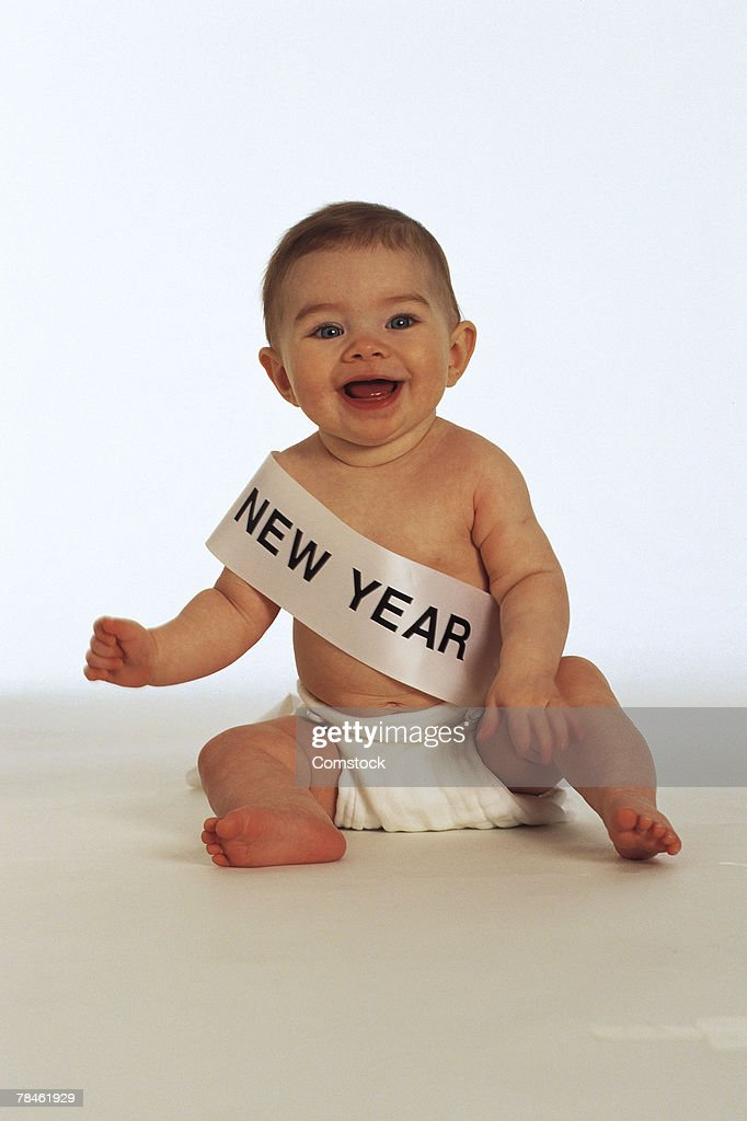 Baby with New Year sash : Stock Photo