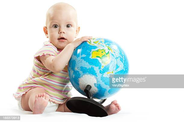 Baby with puzzle globe