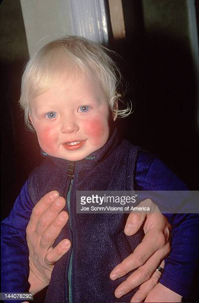A baby with rosy cheeks