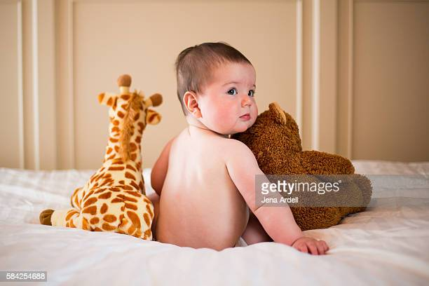 Baby With Stuffed Toys