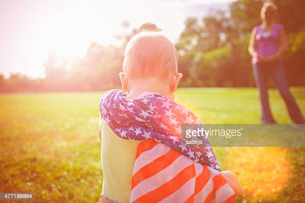Baby wrapped in American flag on the Independence Day