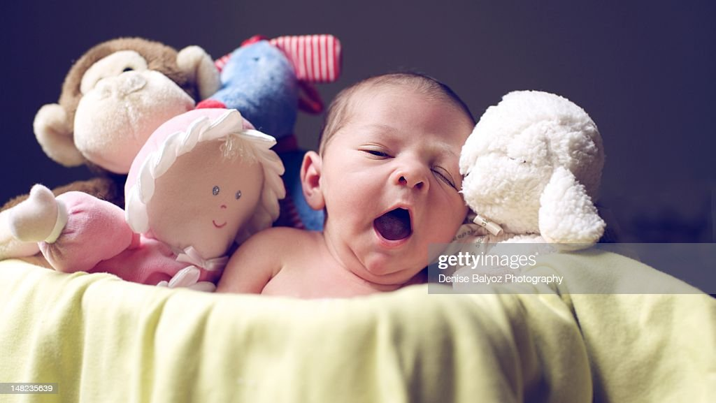 Baby Yawn and Cuddly Friends : Stock Photo