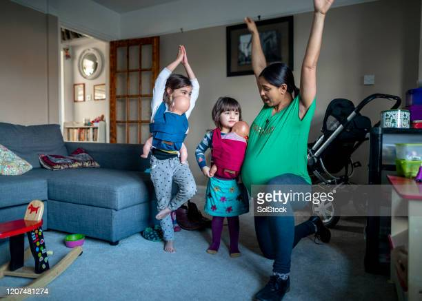 baby yoga - femalefocuscollection stock pictures, royalty-free photos & images