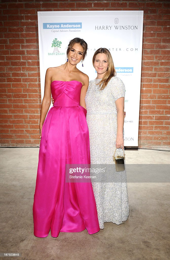 Baby2Baby board member Jessica Alba (L) and honoree Drew Barrymore attend the second annual Baby2Baby Gala, honoring Drew Barrymore, at Book Bindery on November 9, 2013 in Culver City, California.