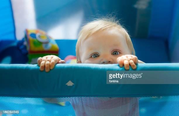 Babygirl inside her playpen
