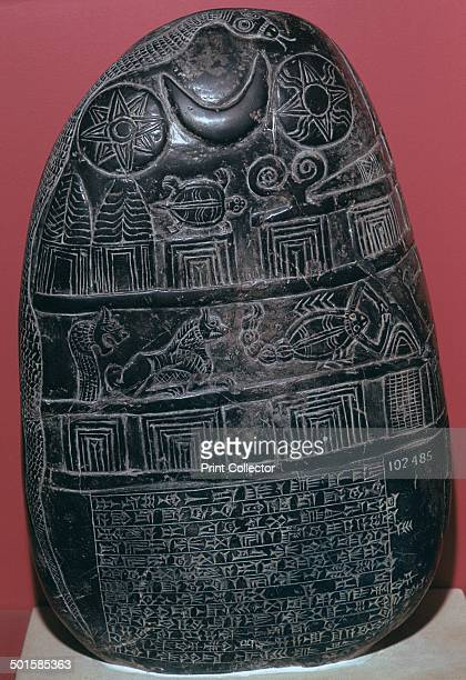 Babylonian boundary-stone, bearing the symbols of the Gods on the stone, representing Gods who protect the deed.