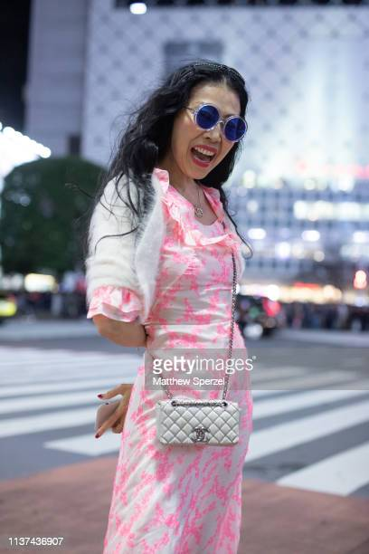 Babymary Faline is seen wearing pink pattern dress white jacket Chanel bag and sunglasses during the Amazon Fashion Week TOKYO 2019 A/W on March 21...